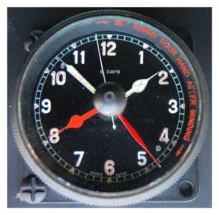spitfire clock. these bezel wound clock mk ii has the called dummy hands (red hands) to set take of time and then on landing flight could be calculated. spitfire i